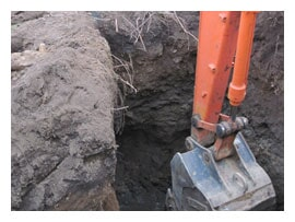 Digging Near Gas Lines Preparing Hole for Septic Tank